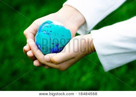 Plasticine earth in children's hand