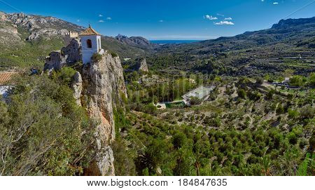 High-Resolution Panorama of Guadalest Castle in Alicante, Spain. Mediterranean sea is visible at the horizon.