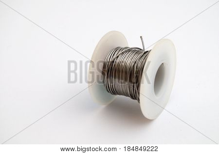 Coiled tin on a clear white background