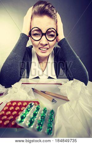 Businesswoman Suffering On Hard Headache.