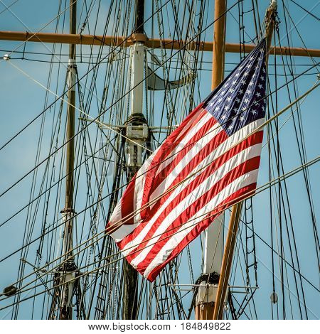 A flag on the back of a sailing ship in southern California.