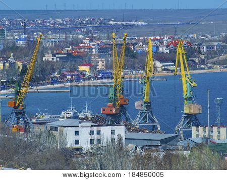 The large cranes in a cargo port on the seashore