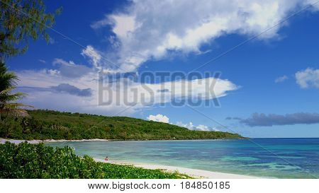 Tachogna beach, Tinian Beautiful blue skies and pristine waters welcome visitors to the Tachogna Beach on Tinian, Northern Mariana Islands.