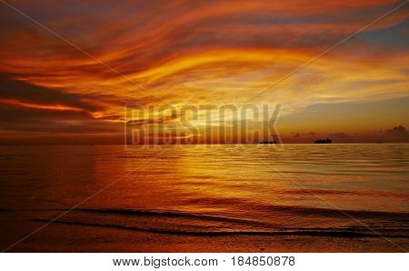 Fiery sunset streaks, Saipan Gorgeous streaks of fiery skies and water reflection