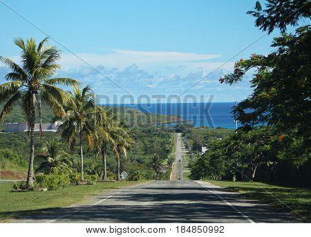 Tinian road, Northern Mariana Islands Sloping road of Tinian leading to San Jose village