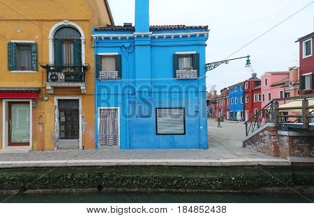 Colorful houses on Burano island street in Italy