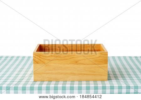 Empty wooden storage box on green checked tablecloth isolated on white background product display montage