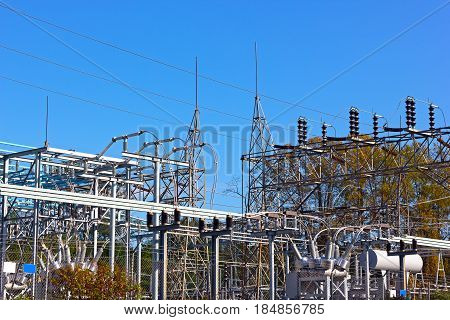 High-voltage equipment at power substation. Industrial urban landscape of power substation in autumn.