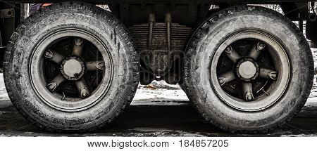 Wheels of a large truck, side view, big truck, truck suspension