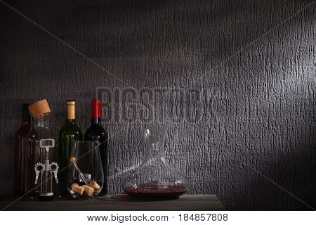 Glass carafe of wine on table against gray background