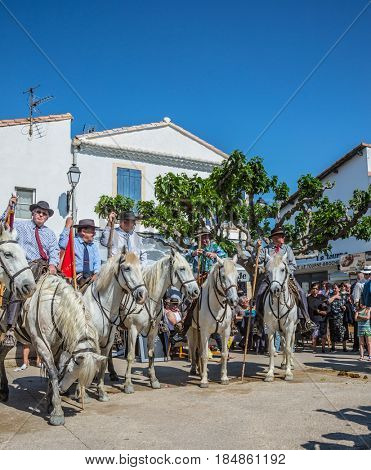 Sent-Mari-de-la-Mer, Provence, France - May 25, 2015.  The concept of ethnographic tourism. World Festival of Gypsies. Convoy - guards on white horses before the start of the parade