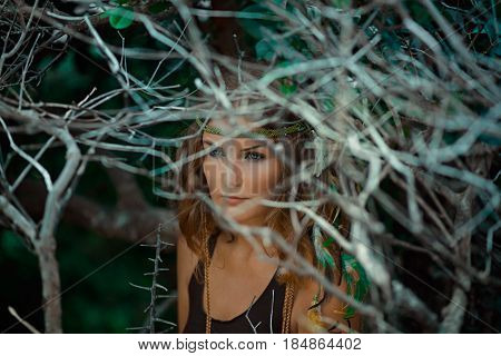 beautiful young woman witch in mystery forest