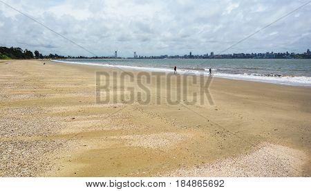 People walking on Catembe beach towards Maputo City