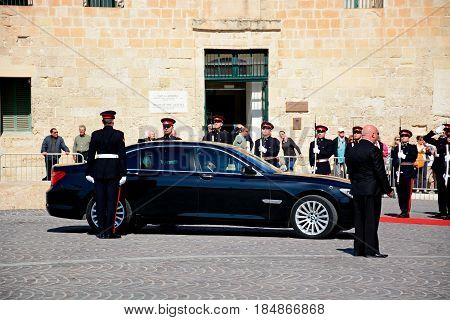VALLETTA, MALTA - MARCH 30, 2017 - Political dignitaries arriving outside the Auberge de Castille for the EPP European Peoples party congress with military personnel in attendance Valletta Malta Europe, March 30, 2017.