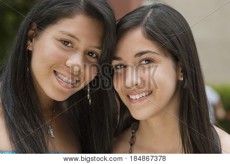 Hispanic sisters smiling