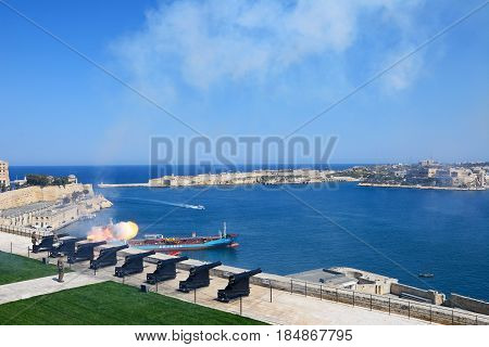 VALLETTA, MALTA - MARCH 30, 2017 - The Noon Gun in the Saluting Battery with views over the bay towards Fort Rikasoli Valletta Malta Europe, March 30, 2017.
