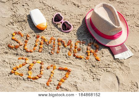 Inscription Summer 2017, Accessories For Sunbathing And Passport With Currencies Dollar On Sand At B