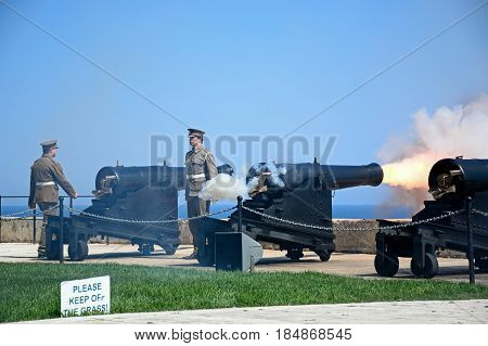 VALLETTA, MALTA - MARCH 30, 2017 - Military personnel firing The Noon Gun in the Saluting Battery Valletta Malta Europe, March 30, 2017.