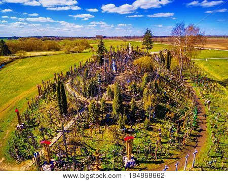 Siauliai region, Lithuania: aerial above view of Hill of Crosses, Kryziu Kalnas. It is a famous religious site of catholic pilgrimage in Lithuania. Beautiful touristic destination in Baltic states.