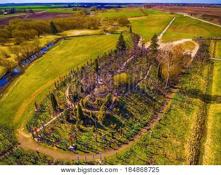 Siauliai region, Lithuania: aerial above view of Hill of Crosses, Kryziu Kalnas. It is a famous religious site of catholic pilgrimage in Lithuania. Beautiful touristic destination in Baltic states. poster