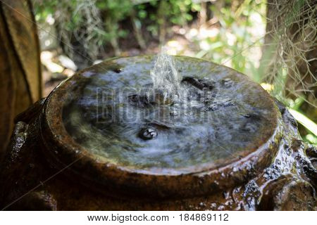 Home Garden Decorated With Vintage Fountain stock photo