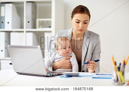 business, motherhood, multi-tasking, family and people concept - happy businesswoman with baby and laptop computer working at office