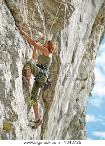 Teenager Rock Climbing