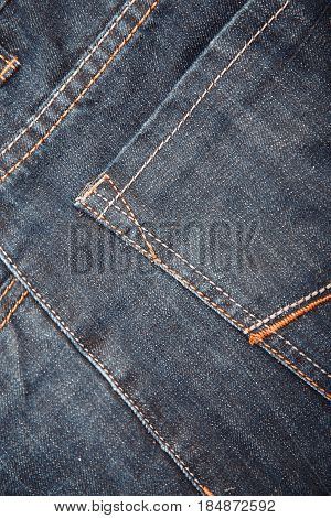 Pocket of the jeans. Close-up vertical photo
