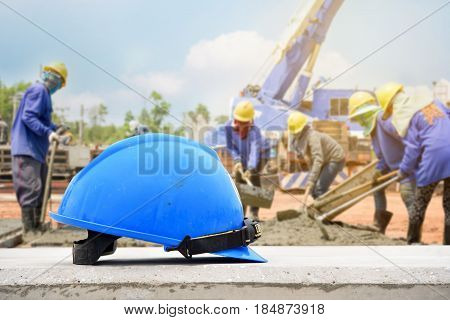 blue helmet in construction site and construction site construction site worker background Construction site safety first concept