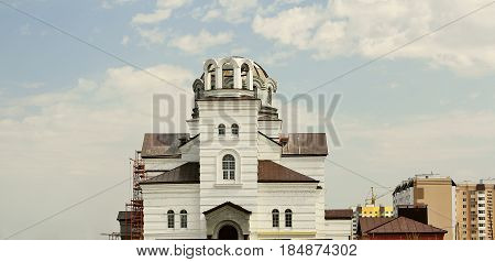 Construction of a Christian church on the outskirts of the city on a spring day.