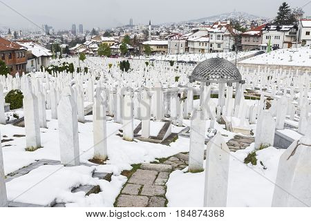 A muslim cemetery in a beautiful winter day in Sarajevo Bosnia and Herzegovina. poster