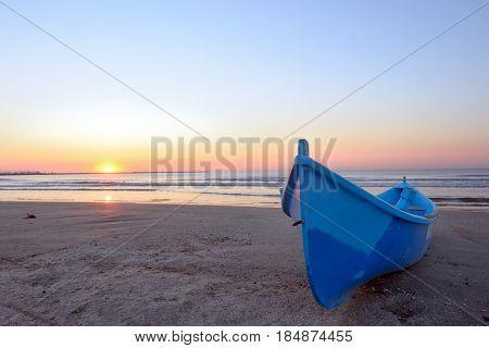Fishing boat and sunrise at black sea