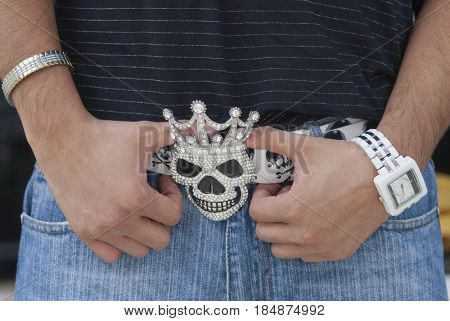 Diamond encrusted skull-shaped belt buckle