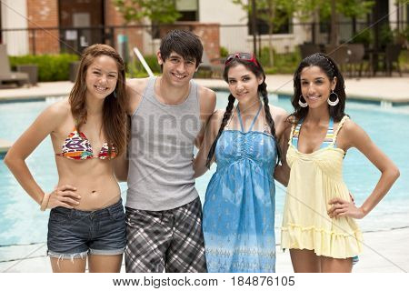 Friends standing outdoors by swimming pool