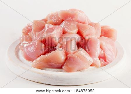 Raw Chicken Meat On  White Wooden Cutting Board.