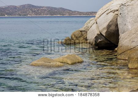 Beautiful Turquoise Sea Water And Rocky Shore