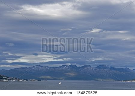 Norway, Tremso    Bay and the snowy peaks of the surrounding area of the Norwegian city of Tremso. Norway