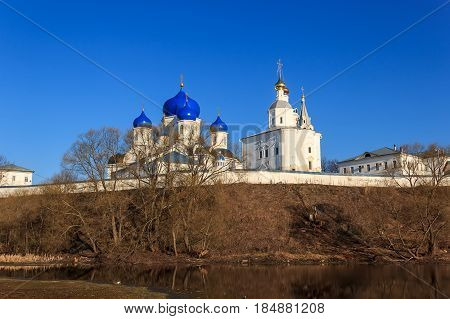 White-stone Monastery With Sky-blue Domes At Early Spring