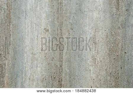 Coarse textured wavy surface of old slate