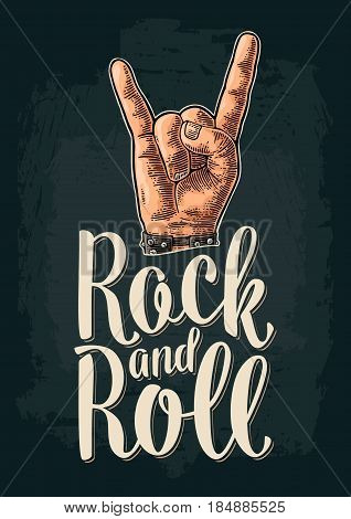 Rock and Roll sign. Hand with metal spiked bracelet giving the devil horns gesture. Vector color vintage engraved illustration with lettering. Isolated on dark background. For festival poster