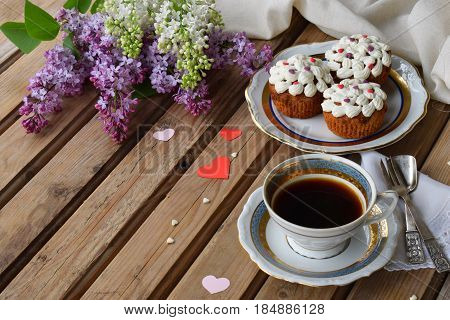 Romantic Composition Of  Bouquet White And Purple Lilacs, Cupcakes With Curd Cream, Cups Coffee On W