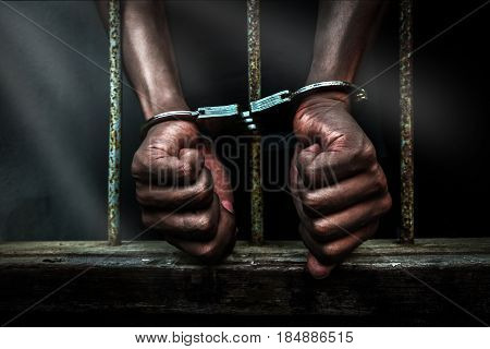 Human hands with handcuff in prison unfreedom concept.
