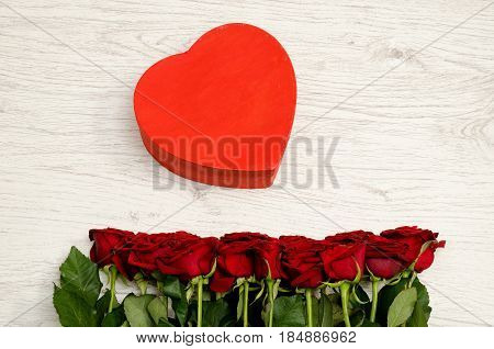 Red Box In The Heartshaped And Roses On A White Wooden Background, Top View