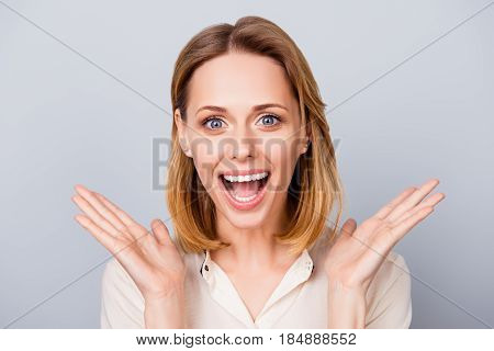 Happy Surprised Young Lady Laughing And Holding Her Hands Near Cheeks