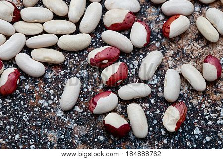 haricot beans background.  Bean beans striped on a dark background.