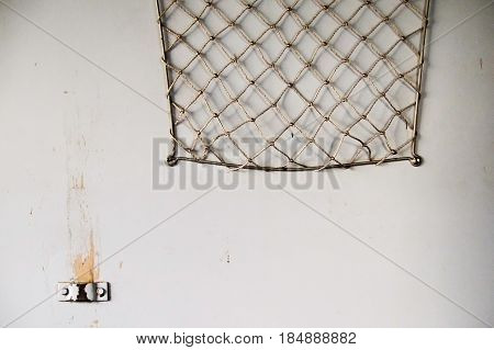 Old bagage net on wall of train.
