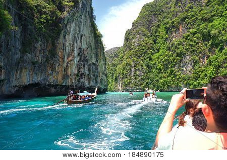 PHI-PHI ISLAND, KRABI, THAILAND-APRIL 30,2017: Speed boat and tourists is snorkel in the Andaman sea at Phi Phi Islands in Krabi province Thailand.
