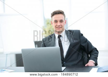 consultant on tax issues at the workplace in front of the open l