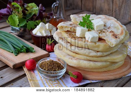 Pile Of Homemade Flat Bread With Lettuce, Cheese, Onion And Radish On A Wooden Background. Mexican F