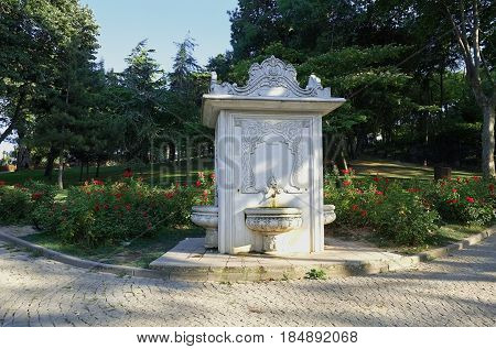 The ottoman style fountain and the rose garden in the Gulhane Park. Gulhane Park (Rosehouse Park) is a historical urban park in the Eminonu district next to the Topkapi Palace in Istanbul. Turkey.